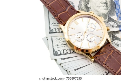 Wrist watch with dollar bills on a white. Top view. Isolated on white.