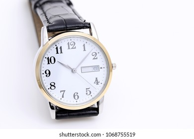 wrist watch with leather strap on white background
