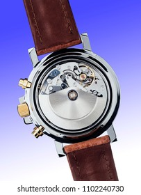 wrist watch mechanism on light blue