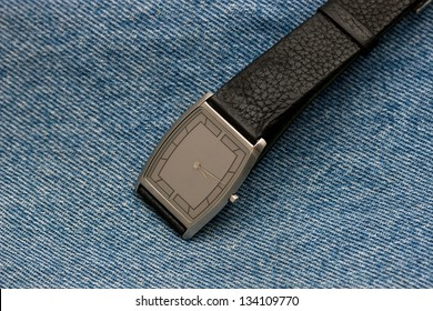 wrist watch on a background made from close up of texture in jeans