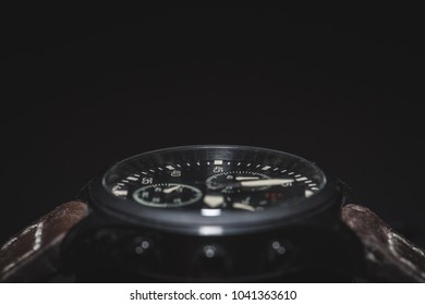 Wrist watch on black background shallow depth of field with leather wrist band