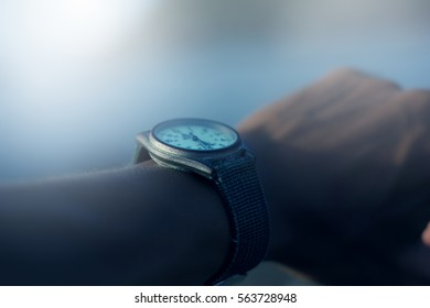 Wrist watch on hand's man.Hand watch.Time.selective focus.blurred background.Image has a vintage effect applied.Process add noise.
