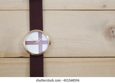 wrist watch on wooden background