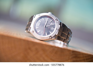 Wrist watch on the wooden table.
