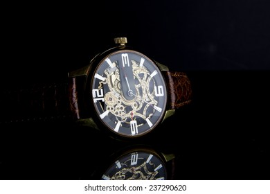 Wristwatch man on black background