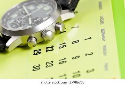 wristwatch on a calendar