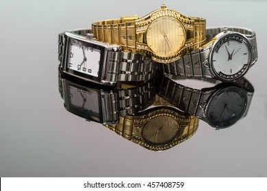 Lot of wristwatch on gray reflective background