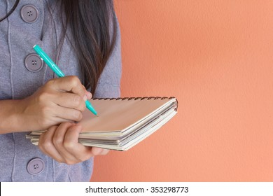Write down on notebook, make a note, student lecture or dictation, focused hand writing on note book