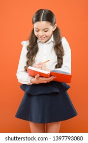 Write essay or notes. Inspiration for study. Back to school. Knowledge day. Schoolgirl enjoy study. Kid school uniform hold workbook. School lesson. Child doing homework. Your career path begins here.