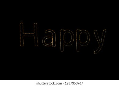 Write sentences with an animated Sparkler light alphabet  on black background. Happy New Year 2019
