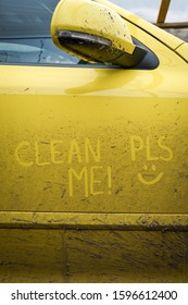 """Write the words inscription text """" clean me """" on the very dirty surface of the car. Concept car wash."""