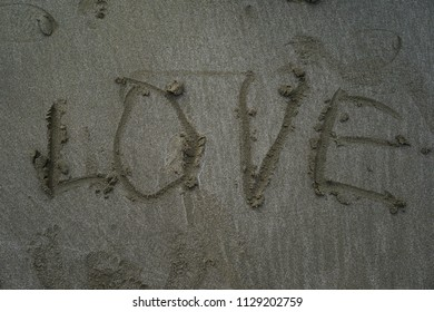 Write words LOVE On the sand
