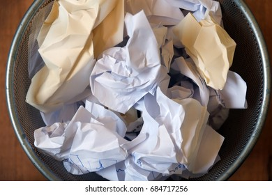 Writer block. Paper basket with wrinkled paper sheets.
