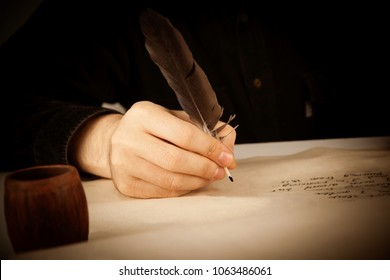 writer holds a fountain pen over writing paper and the writing poems