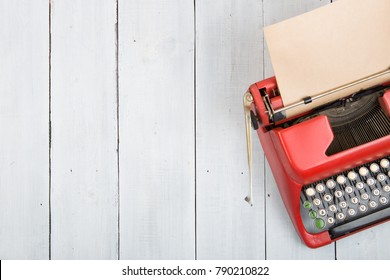 Writer or journalist workplace - vintage red typewriter on the white wooden desk