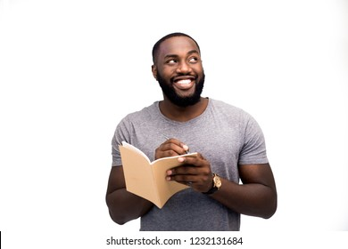 The writer sings writing poems in his notebook, inspired and creative thoughts descended on him. He writes a new literary work, article or prose. Irrational thinking, creative person, believes in goal