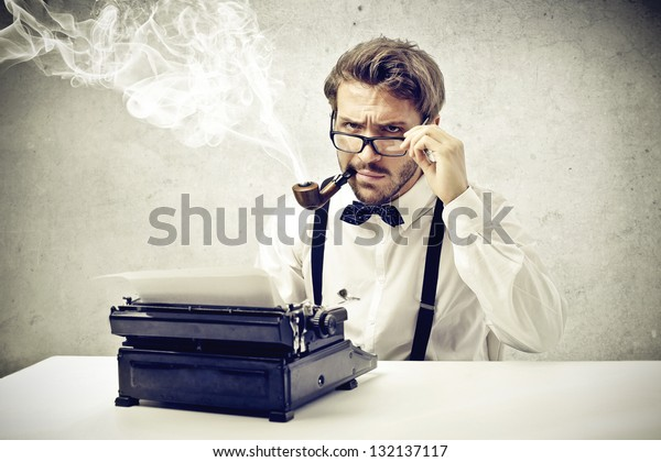 writer smokes a pipe and writes with typewriter