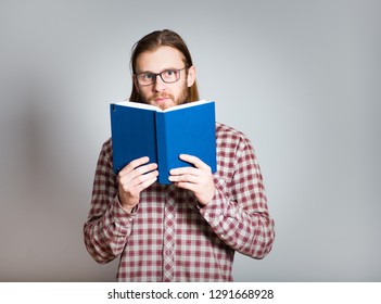 Writer thinker author journalist essay concept. handsome man with a diary, with long hair, isolated closeup