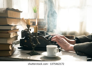 A writer is typing a detective story book page and is smoking a cigarette concept.
