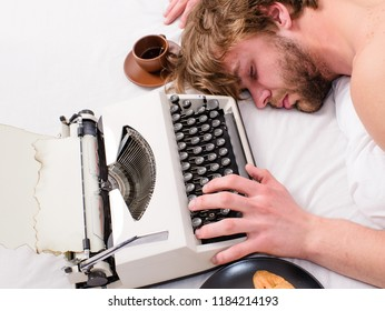 Writer used old fashioned typewriter. Author tousled hair fall asleep while write book. Workaholic fall asleep. Man with typewriter sleep. Exhausting occupation. Man sleepy lay bedclothes while work.