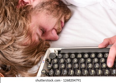 Writer used old fashioned typewriter. Author tousled hair fall asleep while write book. Workaholic fall asleep. Man with typewriter sleep. Deadline concept. Worked all night. Man fall asleep.