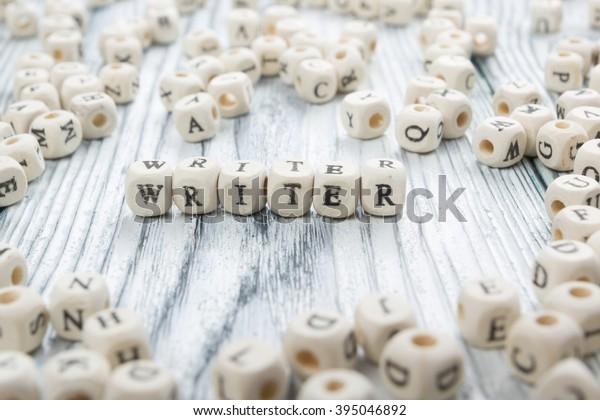 writer word written on wood block. wooden abc