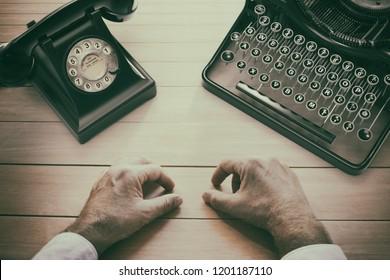 Writer's desk table with typewriter, vintage phone