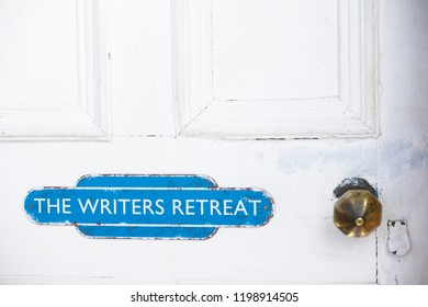 Writers retreat door sign at entrance to quiet room on white weather oak door distressed paint