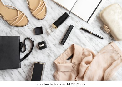 Writing a blog concept. Notebook and pen, woman accessories, clothing, shoes, bag, makeup and perfume white grey background. Fashion and Beauty flat lay.