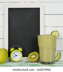 Writing board and fruit smoothies on a white background