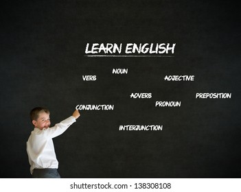 Writing boy dressed up as business man with learn English on blackboard background
