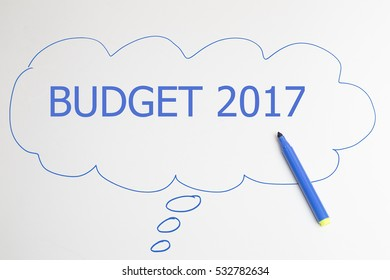 writing BUDGET 2017 with blue marker in talking bubble on white background