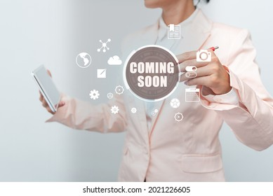 Writing displaying text Coming Soon. Word Written on an event that is bound to happen in the future or about to come Business Woman Touching Digital Data On Holographic Screen Interface.
