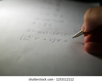 Writing down Schrodinger equation on paper with pencil