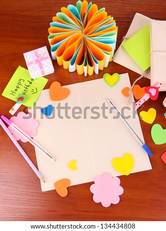 Writing Letter Of Congratulations To Happy Birthday On Wooden Table Close Up
