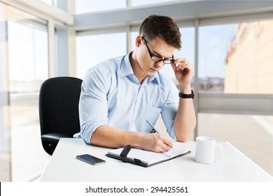 Writing, man, book.