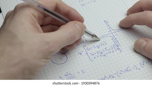 Writing math exercise close up footage