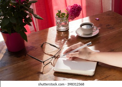 Writing a new note or blog, hand writing in a notebook on the desktop