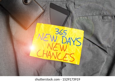 Writing note showing 365 New Days New Chances. Business photo showcasing Starting another year Calendar Opportunities Smartphone device inside trousers front pocket with wallet.