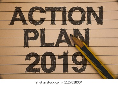 Writing note showing  Action Plan 2019. Business photo showcasing Challenge Ideas Goals for New Year Motivation to Start Ideas concepts on old beige notebook paper pen resting black letters.