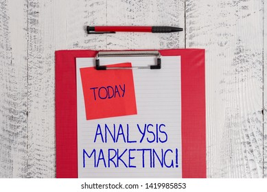 Writing note showing Analysis Marketing. Business photo showcasing Quantitative and qualitative assessment of a market Clipboard paper sheet sticky note ballpoint vintage wooden background.