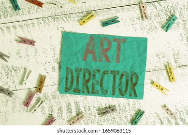 Writing note showing Art Director. Business photo showcasing responsible for overseeing the artistic aspects of a film Colored clothespin rectangle square shaped paper white wood background.