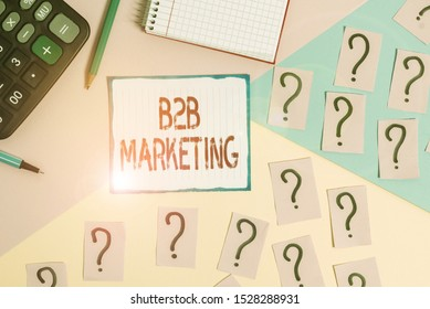 Writing note showing B2B Marketing. Business photo showcasing Partnership Companies Supply Chain Merger Leads Resell Mathematics stuff and writing equipment above pastel colours background.