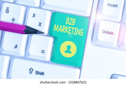 Writing note showing B2B Marketing. Business photo showcasing Partnership Companies Supply Chain Merger Leads Resell White pc keyboard with note paper above the white background.