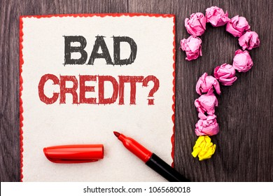 Writing note showing  Bad Credit Question. Business photo showcasing Low Credit Finance Economic Budget Asking Questionaire written on Cardboard Piece With Marker wooden background Question Mark.