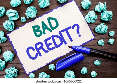 Writing note showing  Bad Credit Question. Business photo showcasing Low Credit Finance Economic Budget Asking Questionaire written on Cardboard Piece on the wooden background Marker next to it.