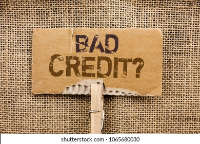 Writing note showing  Bad Credit Question. Business photo showcasing Low Credit Finance Economic Budget Asking Questionaire written on Cardboard Piece Holding By Clip on the jute background.