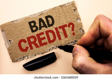 Writing note showing  Bad Credit Question. Business photo showcasing Low Credit Finance Economic Budget Asking Questionaire written by Man Holding Marker on tear Cardboard Piece Plain Background.