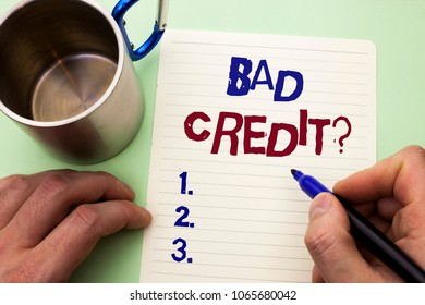 Writing note showing  Bad Credit Question. Business photo showcasing Low Credit Finance Economic Budget Asking Questionaire written by Man on Notebook Paper Holding Marker on plain background Cup.