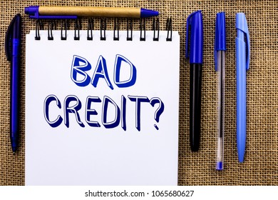 Writing note showing  Bad Credit Question. Business photo showcasing Low Credit Finance Economic Budget Asking Questionaire written on Notebook Book on the jute background Pens next to it.